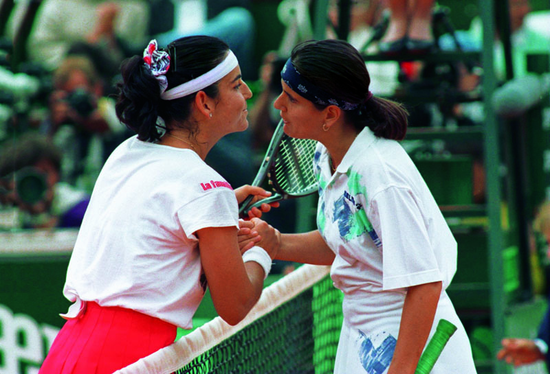 2 JUNE 1994: ARANTXA SANCHEZ-VICARIO MEETS CONCHITA MARTINEZ AT THE NET AFTER WINNING TO ADVANCE TO THE FINALS OF THE FRENCH AT ROAND GARROS IN PARIS. Mandatory Credit: Gary Prior/ALLSPORT