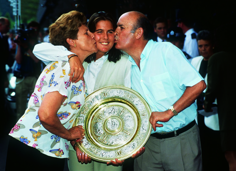 2 JUL 1994: WIMBLEDON CHAMPIONSHIPS FINAL. CONCHITA MARTINEZ OF SPAIN (CENTRE) CELEBRATES WITH HER MOTHER AND FATHER AFTER WINNING THE LADIES FINAL. MARTINEZ WON 6-4 3-6 6-3. Mandatory Credit: Gary Prior/ALLSPORT