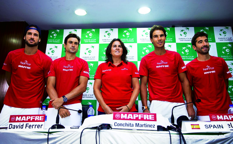 Spanish tennis players, from left, Feliciano Lopez, David Ferrer, Conchita Martinez, Rafael Nadal and Marc Lopez pose for photographs during a press conference ahead of their Davis Cup tennis match against India in New Delhi, India, Tuesday, Sept. 13, 2016. Spain take on hosts India from Sept. 16 to 18. (AP Photo/Saurabh Das)